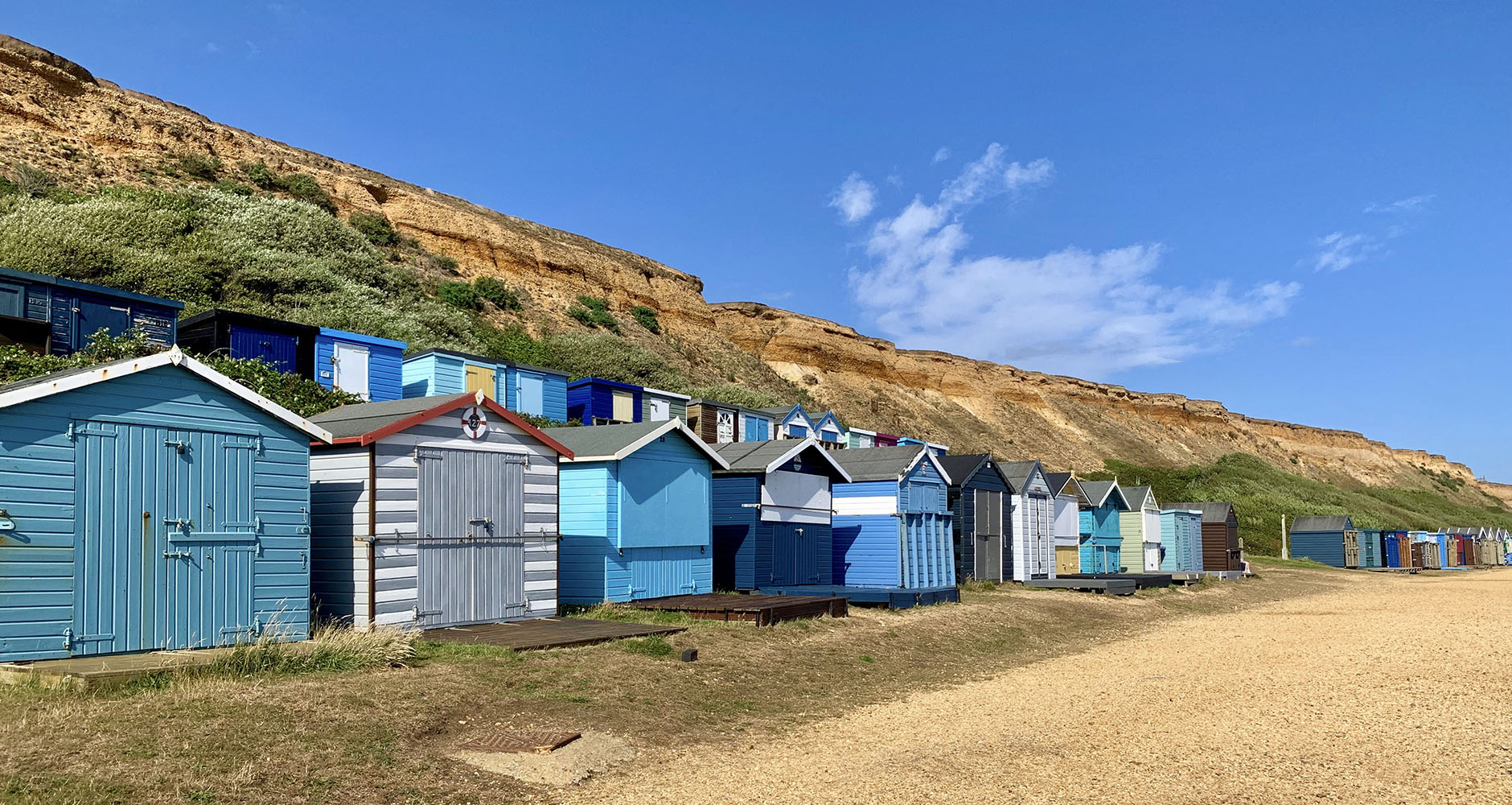 Bright coloured beach huts in Barton-on-Sea