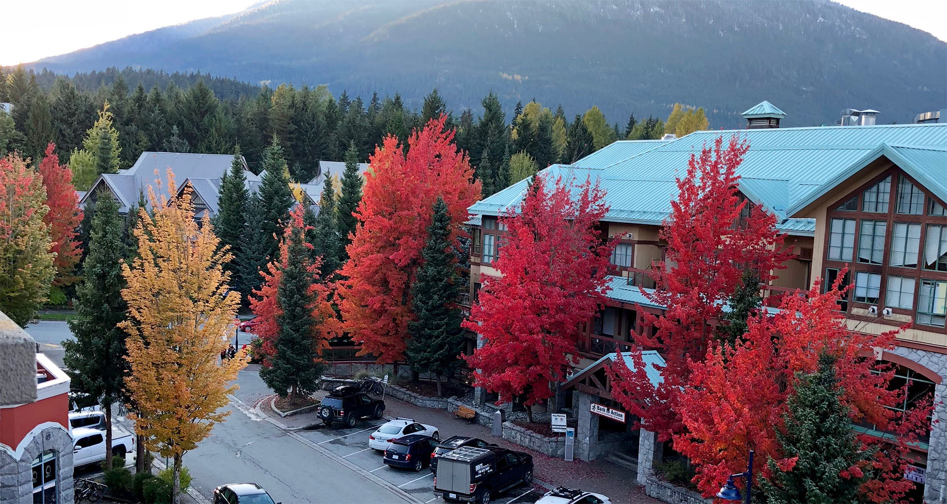 The view from our balcony showing beautiful autumnal trees at Summit Lodge Boutique Hotel in Whistler, Canada